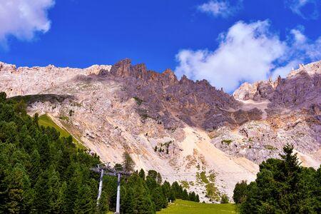 jumps towards the refuge path tower of Pisa latemar (predazzo pampeago) dolomites autonomous province of Bolzano Italy