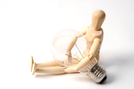 dummy: Dummy with light bulb Stock Photo