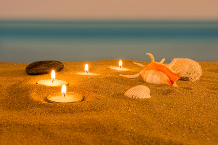 healing plant: Candle on the beach relaxation concept