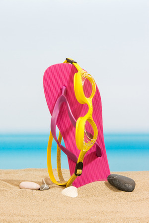 flip flops: Flip flops on the beach
