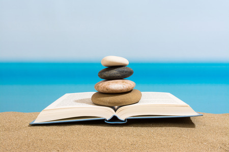 day book: Book on the beach in relax Stock Photo