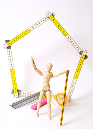 dummy: Dummy engineer builds a house Stock Photo