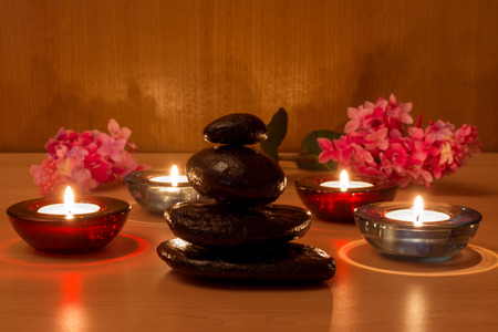 hot rock therapy: Candle and stones relaxation concept