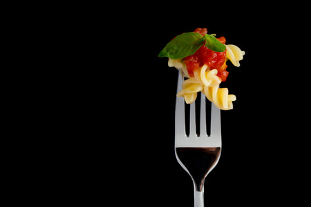 fork: Pasta on black background