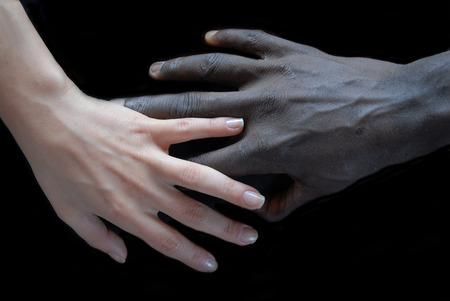 Handshake concept of no apartheid. Hands black and white