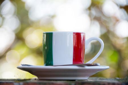 black flag: Italian coffee. Cup with italian flag