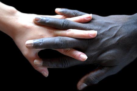 apartheid: Handshake concept of no apartheid. Hands black and white