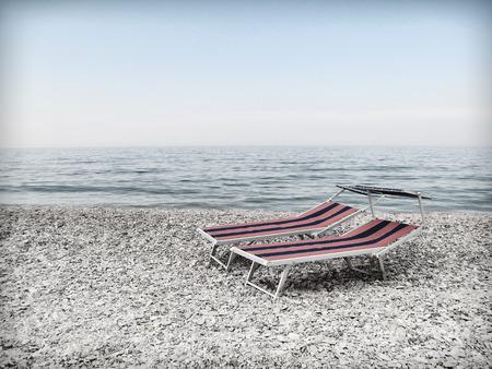 abandonment: Vintage beach autumn to the sea