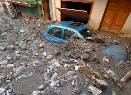 tragedies: city hit by a landslide and a flood Stock Photo