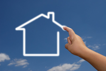 real estate planning: Hand drawing a house in the sky Stock Photo
