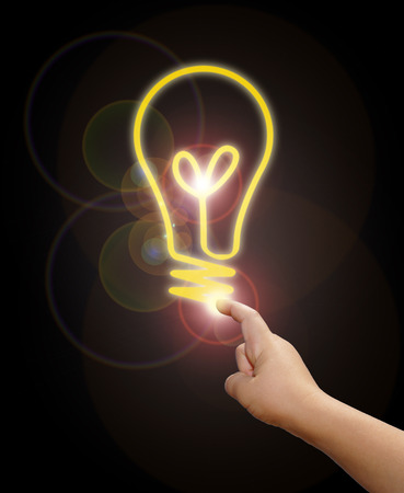 inclination: hand with light bulb idea concept Stock Photo