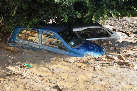 instability: city hit by a landslide and a flood Stock Photo