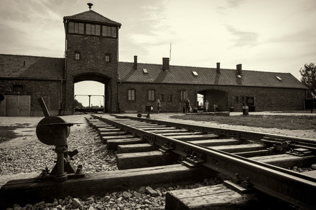 birkenau: Main gate and railroad to nazi concentration camp of Auschwitz Birkenau Editorial