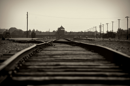 killings: Main gate and railroad to nazi concentration camp of Auschwitz Birkenau Editorial
