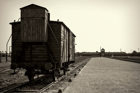 auschwitz memorial: Main gate and railroad to nazi concentration camp of Auschwitz Birkenau Editorial
