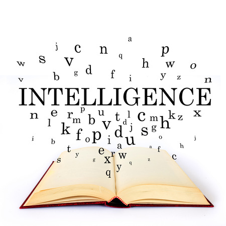 write background: Intelligence, word on the book with letters flying Stock Photo