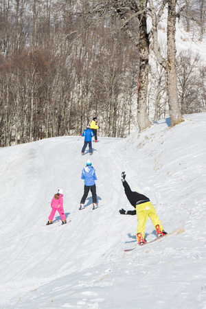 skiers: TERMINILLO, ITALY - JANUARY 02, 2015: Skiers on the slope of Ski resort Terminillo, mountains Apennines, central Italy. This is the most important ski resort of the Lazio.