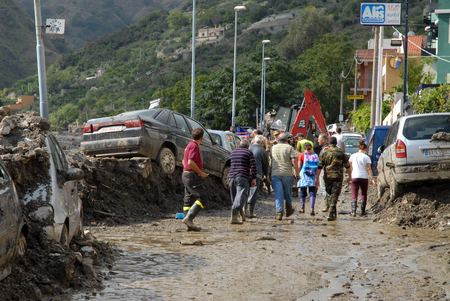instability: Giampilieri,Italy -  October 3,  2009. A landslide has invaded the Sicilian town causing many deaths. The collapse of a mountain caused hundreds of tons of earth and rock fell on buildings and cars. Editorial