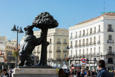MADRID, SPAIN - october 31, 2013: Bear and the Madrono Tree Statue on the square Puerta del Sol in Madrid. It is the heraldic symbol of Madrid Editorial