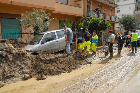 invaded: Giampilieri,Italy -  October 3,  2009. A landslide has invaded the Sicilian town causing many deaths. The collapse of a mountain caused hundreds of tons of earth and rock fell on buildings and cars. Editorial