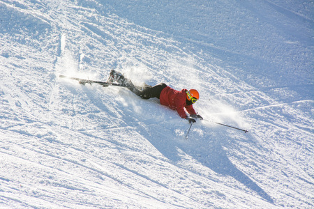 TERMINILLO, ITALY - JANUARY 02, 2015: Skier falling on the slope of Ski resort Terminillo, mountains Apennines, central Italy. This is the most important ski resort of the Lazio.