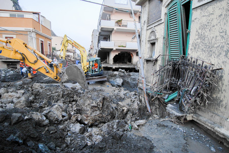 invaded: Scaletta Marina,Italy -  October 3,  2009. A landslide has invaded the Sicilian town causing many deaths. The collapse of a mountain caused hundreds of tons of earth and rock fell on buildings and cars.