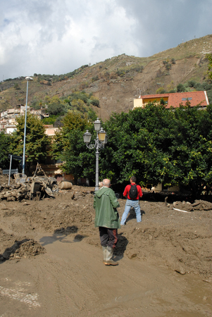 mud slide: Giampilieri,Italy -  October 3,  2009. A landslide has invaded the Sicilian town causing many deaths. The collapse of a mountain caused hundreds of tons of earth and rock fell on buildings and cars. Editorial