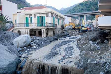 mud slide: Scaletta Marina,Italy -  October 3,  2009. A landslide has invaded the Sicilian town causing many deaths. The collapse of a mountain caused hundreds of tons of earth and rock fell on buildings and cars.