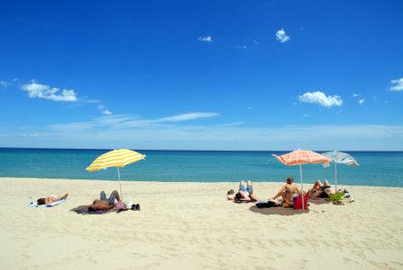 sun bathers: Arbatax,Italy - June14, 2008:  Bathers on the beach of Arbatax in Sardinia