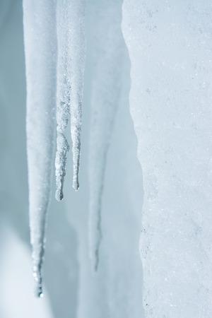 stalactites: Winter background. Ice stalactites that drips