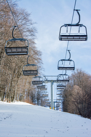 without people: chairlift without people on a snowy mountain