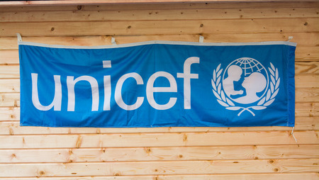 unicef: ROME, Italy - December 9, 2015: Banner of Unicef hanging on wood