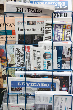 news stand: ROME, Italy - november 24, 2015: International newspapers and magazines on display in Rome.