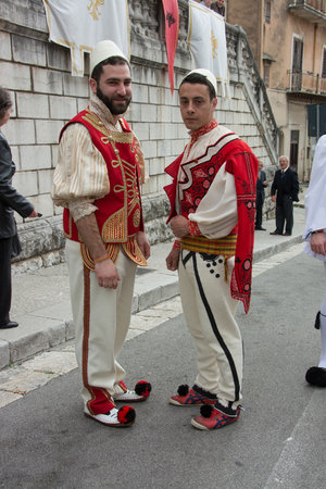 rite: PIANA DEGLI ALBANESI, ITALY - April 20, 2014: Holy Week in Sicily. Easter procession of women and men, greek byzantine rite,  dressed in the traditional costumes of the Albanian 400.
