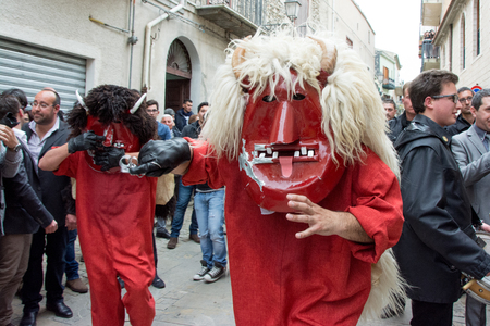 holy week: PRIZZI, ITALY - April 20, 2014: Holy Week in Sicily. Traditional Festival Dance of the Devils in Easter.  It is represented with the death and two devils go in search of souls. The eternal struggle of good and evil. Editorial