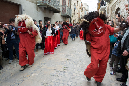 procession: PRIZZI, ITALY - April 20, 2014: Holy Week in Sicily. Traditional Festival Dance of the Devils in Easter.  It is represented with the death and two devils go in search of souls. The eternal struggle of good and evil. Editorial