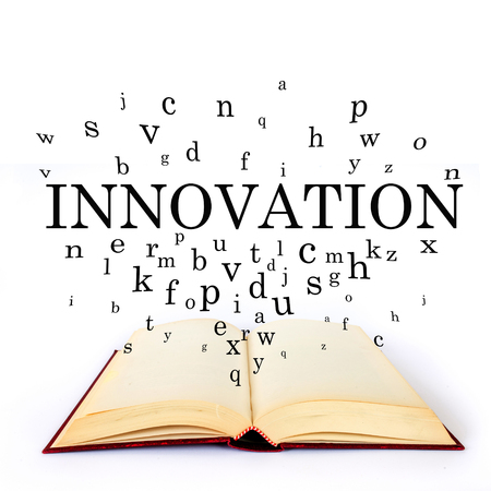innovation word: Innovation, word on the book with letters flying