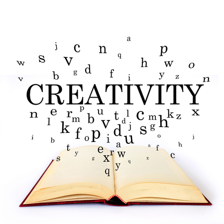 Creativity, word on the book with letters flying