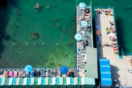 sorrento: Sorrento, Italy - June 18, 2016: View of the beach and bathers.