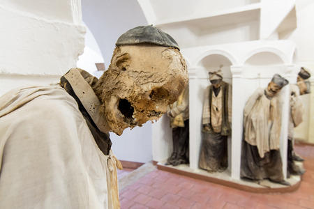 mummified: GANGI, ITALY -  July 03, 2016: The crypt of the mother church, where all priests are buried mummified. Editorial