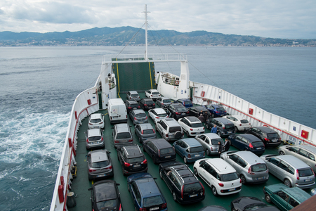 Messina, Italy - December 30, 2015: Ferryboat with many tourists and cars on board. This ship connecting Calabria and Sicily on Strait of Messina, waiting of the bridge