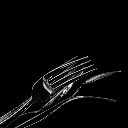flatware: Abstract shapes with flatware on black background