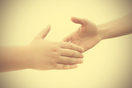 pact: Pact between a youth and an adult with a handshake