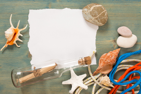 castaway: Summer background on wood with message in bottle, copy space