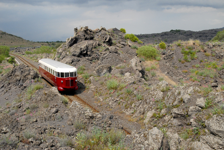 Catania, Italy - June 03, 2008: Tourist railway Circumetnea. The historic train Fiat, named Littorina, that travels around the Etna volcano, in the middle of the lava. Sajtókép