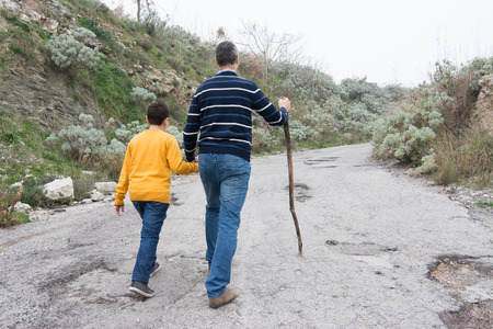 escorting: Father accompanies his son in an uphill climb. Teaching concept to life