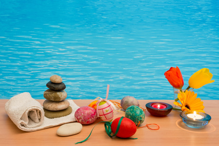 swimming candles: Easter in pool, wellness and relax. Eggs and water background for party and spa