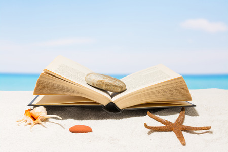 Book on the beach with white sand