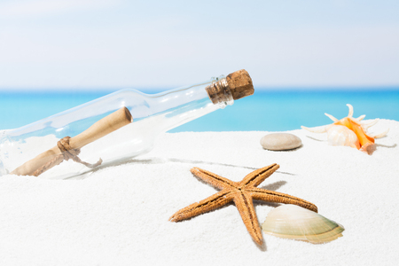 Message in bottle on beach with white sand,  in tropical sea Stock Photo