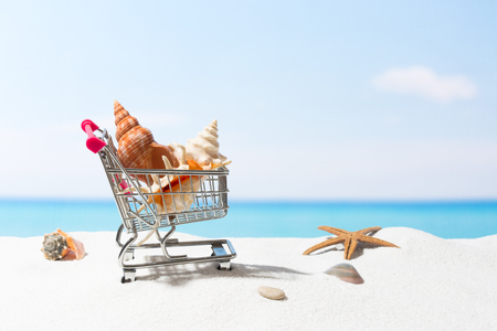 Summer shopping.  Business and selling on beach. Cart on white sand Stock Photo